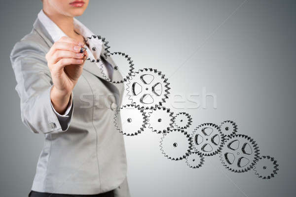 businesswoman drawing a sketch of the mechanism Stock photo © adam121