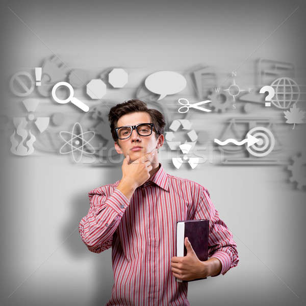 young man scientist with glasses thinking Stock photo © adam121