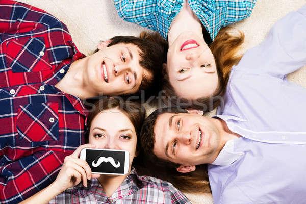 Cuatro los hombres jóvenes mentir junto jóvenes mujer atractiva Foto stock © adam121