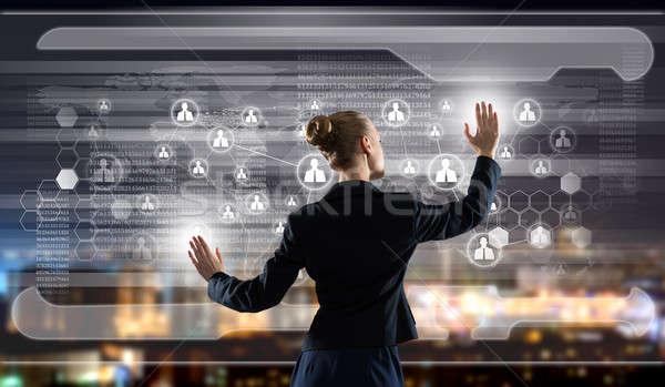 革新的な 技術 背面図 女性実業家 触れる アイコン ストックフォト © adam121