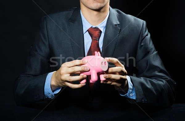 Megtakarított pénz jövő üzletember tart rózsaszín persely Stock fotó © adam121