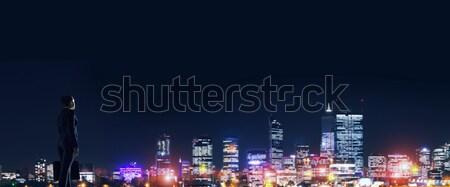 üzletasszony éjszaka izzó város áll hát Stock fotó © adam121