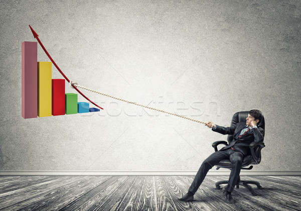 Businessman pulling graph with rope as concept of power and cont Stock photo © adam121