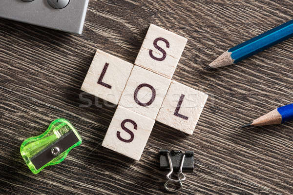 Words SOS and LOL on table made of wooden cubes elements Stock photo © adam121