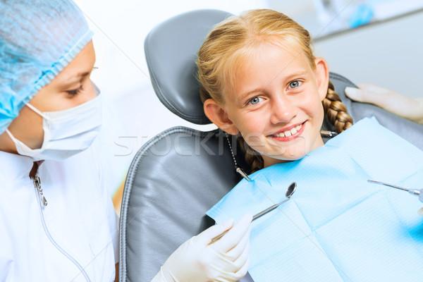 Dentista paziente piccolo cute ragazza seduta Foto d'archivio © adam121