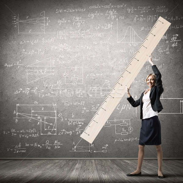 Woman with ruler Stock photo © adam121