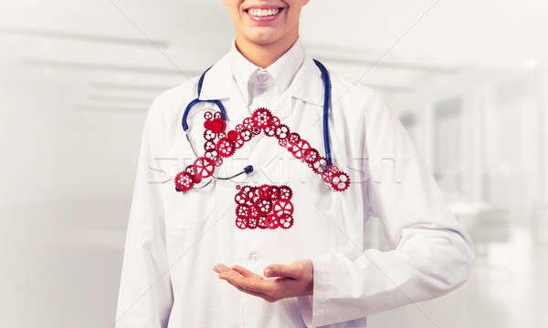 Simbolo homepage mano donna medico Foto d'archivio © adam121