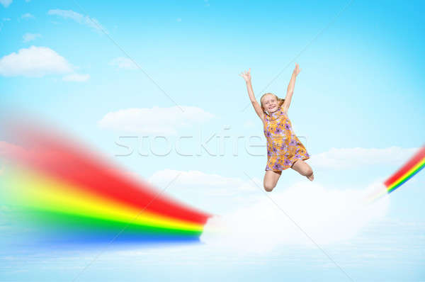 girl jumping on clouds and a rainbow Stock photo © adam121