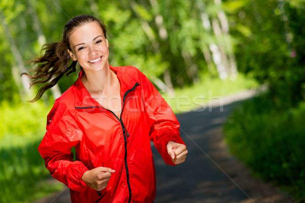 Saludable jóvenes femenino atleta ejecutando verano Foto stock © adam121