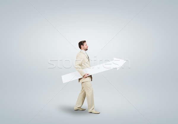 Empresario flecha guapo caminando blanco lugar Foto stock © adam121