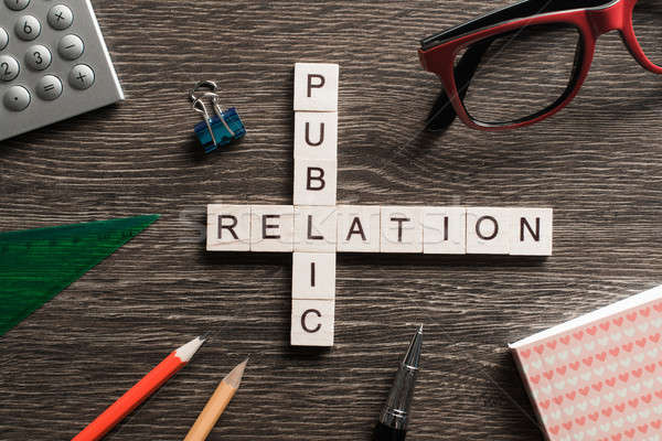 Public Relation crossword on office table collected of wooden cubes Stock photo © adam121