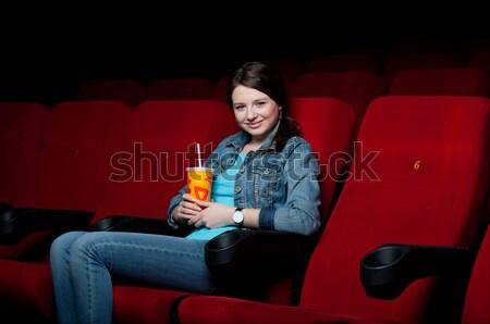 Młodych atrakcyjna kobieta posiedzenia kina film Zdjęcia stock © adam121