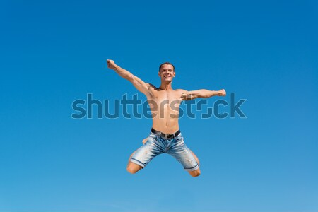 shirtless man against blue sky Stock photo © adam121