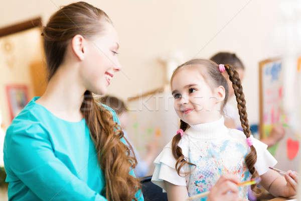 teacher talks to a schoolgirl Stock photo © adam121