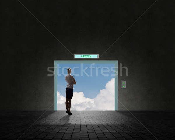 business woman standing near an open door Stock photo © adam121