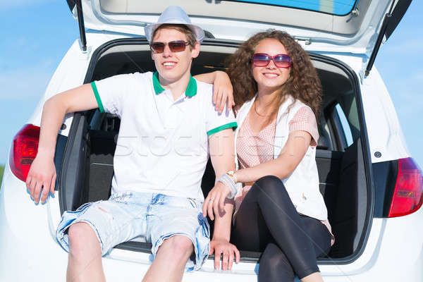 young couple sitting in the open trunk Stock photo © adam121