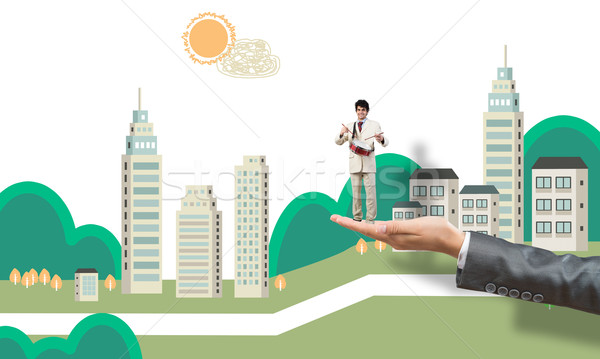 Palm supporting businessman Stock photo © adam121