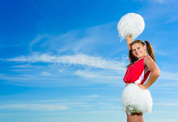 Fiatal pompomlány piros jelmez kék ég divat Stock fotó © adam121