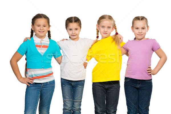 Mała grupa dziewcząt inny plecy stoją rząd Zdjęcia stock © adam121