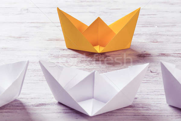Business leadership concept with white and color paper boats on  Stock photo © adam121