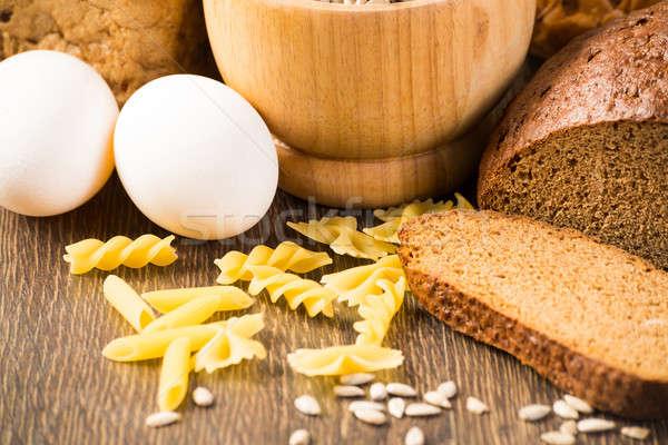 Fresh bread, eggs, pasta and grains Stock photo © adam121