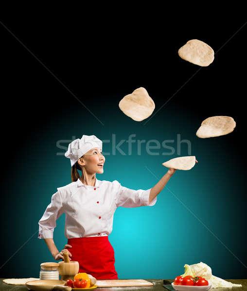 Chef jongleren stukken pizza asian vrouw Stockfoto © adam121