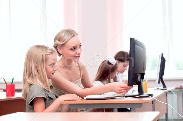 Maestro tarea colegiala ordenador nuevos Foto stock © adam121