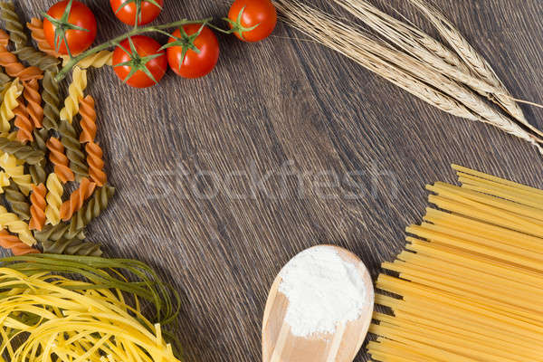 Stock photo: pasta, tomatoes and flour on the spoon