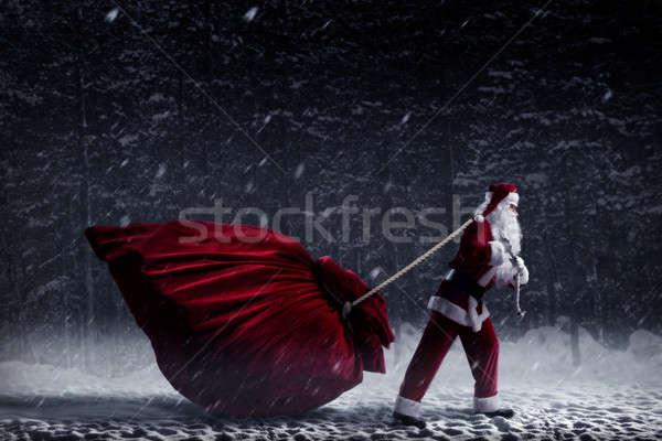 Mikulás hatalmas táska ajándékok éjszaka tél Stock fotó © adam121