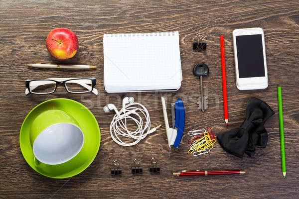 Mesa naturaleza muerta taza café bloc de notas teléfono celular Foto stock © adam121