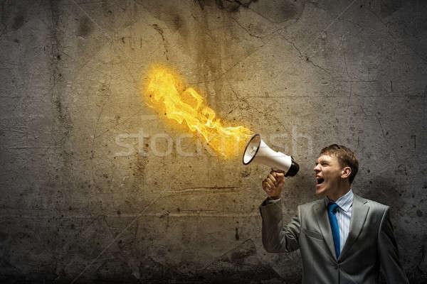 Agressivo gestão jovem empresário gritando fogo Foto stock © adam121