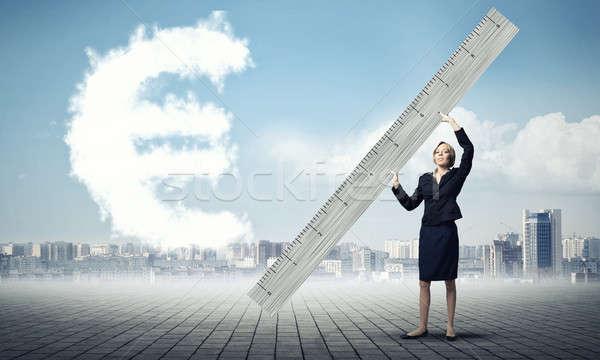 Nő vonalzó fiatal üzletasszony mér Euro Stock fotó © adam121
