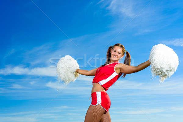 Jovem chefe de torcida vermelho traje blue sky moda Foto stock © adam121