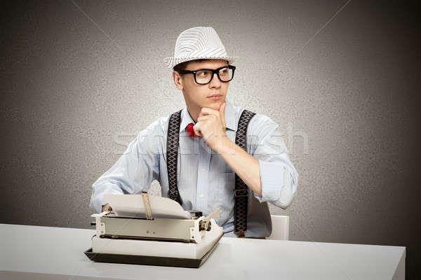 молодые журналист изображение сидят таблице машинку Сток-фото © adam121