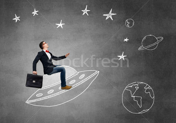 Guy ride UFO ship Stock photo © adam121