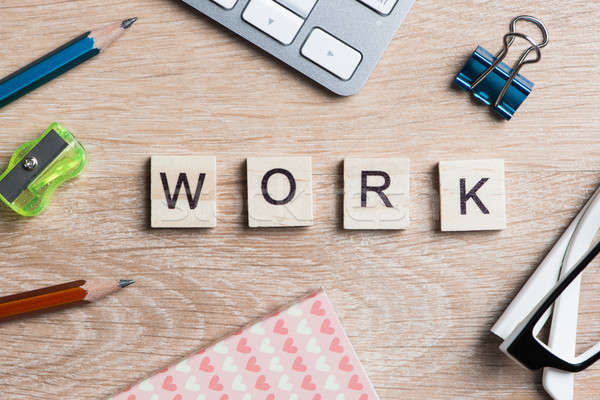 Elements of game with letters spelling business keywords on workplace Stock photo © adam121