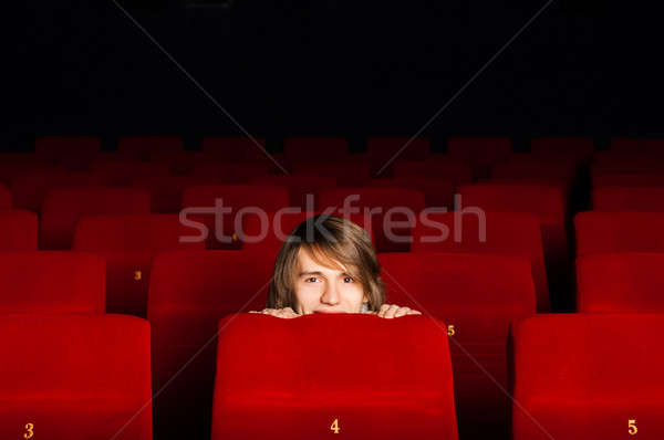 young man in the cinema hiding behind a chair Stock photo © adam121