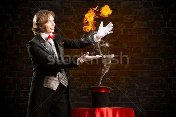 Mago corriente fuego fuera sombrero resumen Foto stock © adam121