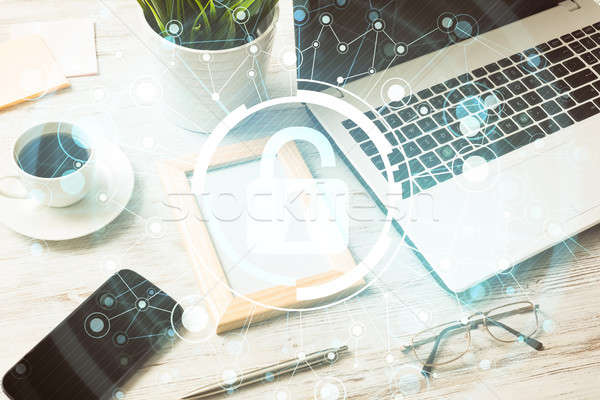 Business workplace with laptop coffee cup and security concept o Stock photo © adam121