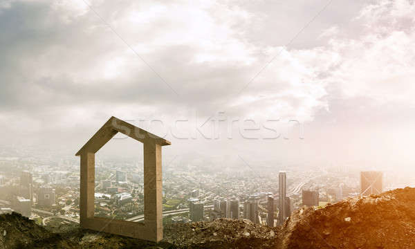 Conceptual image of concrete home sign on hill and natural lands Stock photo © adam121