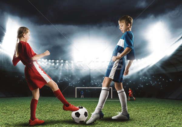 Jogo de futebol dois adolescentes escolas idade jogar Foto stock © adam121