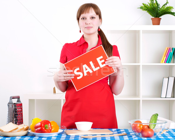 Stock photo: girl holding sale sign