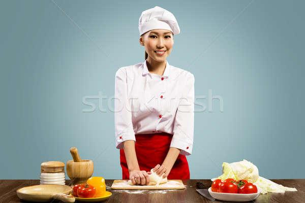 Asian female chef cooking pizza dough Stock photo © adam121
