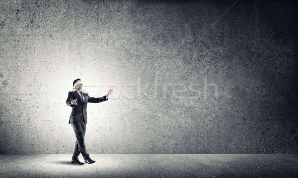 Business concept of risk with businessman wearing blindfold in e Stock photo © adam121