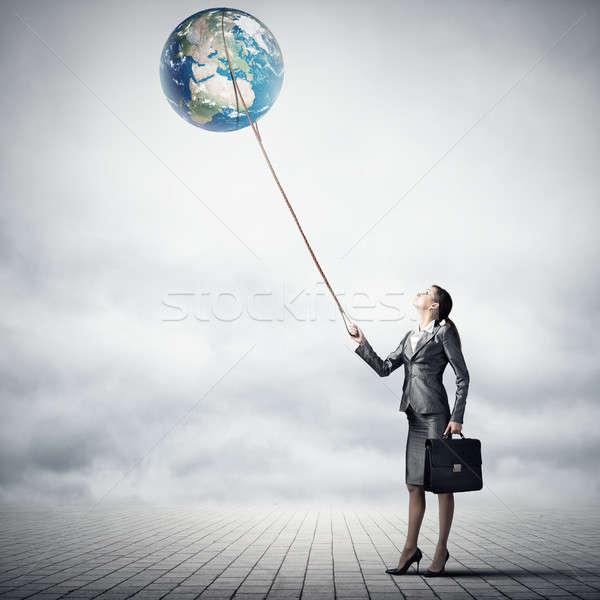 Woman catch Earth planet Stock photo © adam121