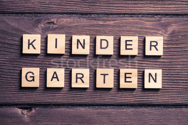 wooden elements with letter collected to word kinder garten Stock photo © adam121