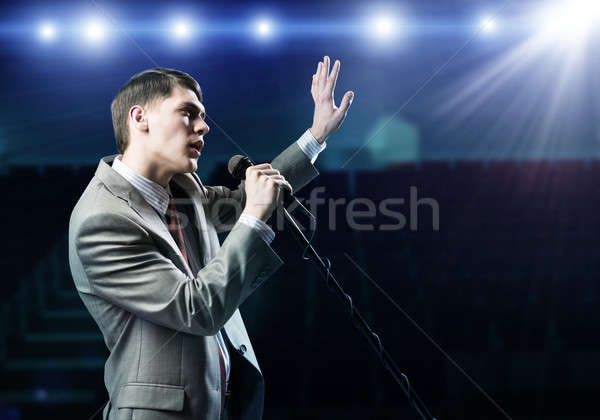 Businessman with microphone Stock photo © adam121
