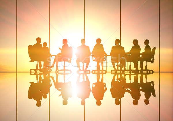 üzleti megbeszélés sziluettek csoport üzletemberek naplemente nők Stock fotó © adam121