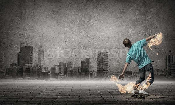 Teenager boy on skate Stock photo © adam121
