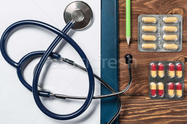 Desk of doctor with medicine things Stock photo © adam121